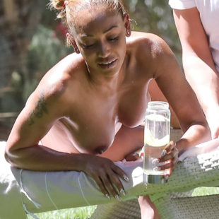 Melanie Brown Exposes Her Nude Tits While Tanning Topless