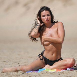 Jenny Thompson Poses Topless And Bikini On A Beach