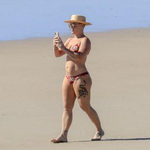 Pink Caught Sunbathing In Bikini On A Beach