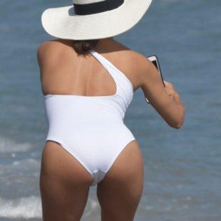 Eva Longoria Caught Wearing White Swimsuit On A Beach