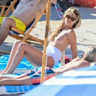 Heidi Klum Caught Topless And Swimsuit On A Beach