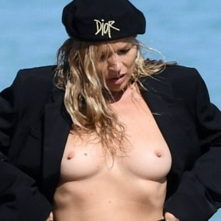Kate Moss topless during beach photoshoot
